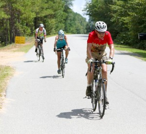 Cyclists, Larry Kloet (front) and Nancy Wylie (rear), along with another rider, depart the Bison Valley Lodge rest stop and make their way to Plains in the ride's final stretch on August 30.