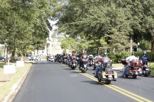 The motorcade carrying former POWs and families of those still missing in action enters the main gates of the Georgia Southwestern State University campus Friday afternoon.