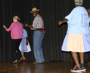 Americus Times-Recorder editor Beth Alston and Sumter County Sheriff's Chief Deputy Col. Eric Bryant dance withe Buena Vista Denim Daisies dance group.