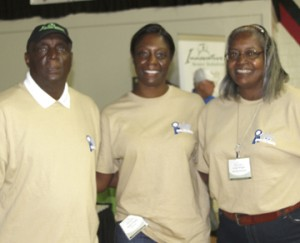 ISS co-owner and co-founder Jessica Wright, center, is flanked by her parents Arthur Wright and Evelyn Wright.