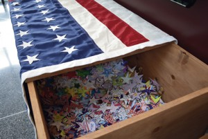 Memory stars on display in ceremonial casket at Andersonville National Cemetery Friday.