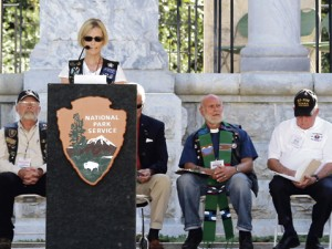 Pam Cain, daughter of Col. Oscar Mauterer, at the podium Friday morning at Andersonville National Cemetery.