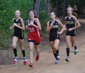 Submitted by Patrick Calcutt:   Lady Raider Cross Counry runners participating in the Americus meet, from left: Calyn Fort, a member of the Southern Christian Academy team, Sydney Hayes, and  Ryleigh Bell,
