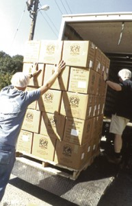 And finally, after all the meals are made and packed, they're loaded onto a truck to get them to the people who need them.