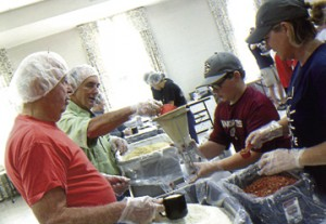 From left are the Rev. Bill Dupree, Phil Guest, Jake DeBarge and Kerry DeBarge working on their part of the meals.