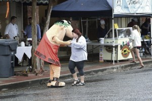 'Little Caesar' enjoys a dance with a young lady attending Taste of Sumter 2015 Thursday downtown.