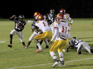 Michael Murray/Americus Times-Recorder:   Schley's Calvin Sims dashes around the right side of Dooly's defensive line in the Wildcats' Oct.16  contest against the Bobcats.