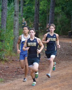 Submitted by Patrick Calcutt:   Americus-Sumter senior, Heeral McGee, (L) battles with Southland's Billy Calcutt (center) and Brian Miller (R) on the first mile at the October 10 Invitational