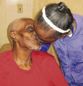 T. Liller Pless plants an affectionate kiss on her husband of 76 years.