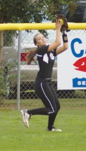 Photo by Tammy Satterfield:   Schley's Bethany Phillips  pulls down an opponents' fly ball deep in the outfield during an early October contest.