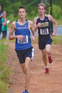 Submitted by Patrick Calcutt:    Southland's Wright Calhoun (R) battles on the first mile with Trinity-Dublin's Jacob McLeod (L).