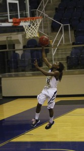 Michael Murray/Americus Times-Recorder:   Ja'Quasha Sesler follows a steal with a fast-break lay-up during the first half of the Lady 'Canes' Nov. 21 match against Southeastern University.