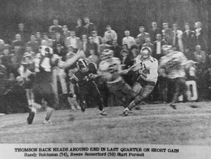 """ATR File Photo:   This photo, from the Nov. 27, 1965 edition of the Times-Recorder shows a Thomson running back attempting to slip past the Panthers' defensive line. The original caption reads: """"Thomson back heads around end in last quarter on short gain. Randy Robinson (74), Reese Summerford (50) start pursuit."""""""