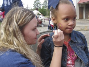 Saniyah Hightower, 5, has her face painted with a lovely pink flower, saying that was her favorite part of the festival.