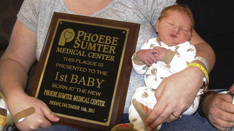 John-Michael and his mother were presented a plaque commemorating his status as the first baby born in the Phoebe Sumter Medical Center.