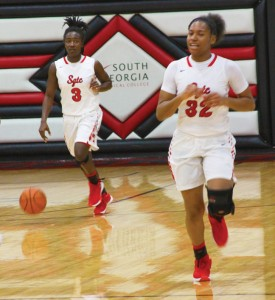 Michael Murray/Americus Times-Recorder:   SGTC's Brittney Delva (3) and Cierra Bond (32) move the ball down the court in a recent home contest. against Georgia Highlands. Bond led the Lady Jets in their victory over Snead State on Dec. 16. Delva dished out nine assists in the Lady Jets' win over Indian River on Dec. 17.