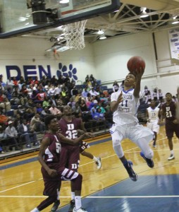 Michael Murray/Americus Times-Recorder:   Eric Hall (11) takes a powerful leap for a lay-up during an early December contest against Dougherty in Americus. Hall contributed 10 points to the Panthers' Dec. 18 victory over Colquitt County.