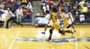 Michael Murray/Americus Times-Recorder:   This previously-unpublished ATR file photo shows Atyanna Gaulden making a break for the basket past a pair of Carrollton defenders in the third round of the 2014-15 state playoffs. Her teammate, Timia Swanson, follows close behind in the Feb. 24 match. Gaulden went on to sign a letter of intent to join Florida State University's basketball team during the 2016-17 season.