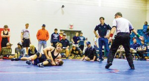 Submitted by Patrick Calcutt:   This photo, previously unpublished in the Times-Recorder, shows 2015 Southland graduate, Ryan Landreth pinning an opponent during the GISA region 3-IAAA wrestling tournament in Albany. Landreth took first place honors in the 145-pound weight class in the tournament. Landreth would go on to win the state championship in his weight class a few weeks later.