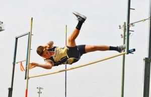 Photo by Dawn Shattles:   This photo, by Dawn Shattles, from the 2015 football season depicts her youngest son, Brodie Shattles, as he narrowly clears the bar during the pole vault competition at Deerfield's 2015 track and field meet.