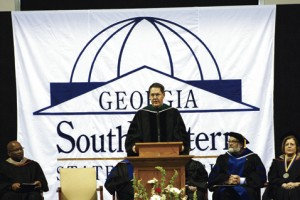 Commencement speaker Sen. Dean Burke addressing the graduates.