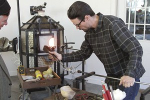 Warner Robbins-based glassblower, Chris Fiertner, gives a demonstration of the mobile unit's capabilities during Mobile Glassblowing, LLC's Open House on Dec. 19 in Americus.