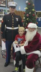 Caleb Kemp sits on Santa's lap