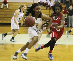 Michael Murray/Americus Times-Recorder:   Chelsey Carter moves the ball down the court during the Lady Wildcats' Jan. 5 contest against the Lady Red Devils.
