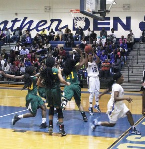 Michael Murray/Americus Times-Recorder:   ASHS' Timia Swanson tosses in a lay-up during the Lady Panthers' Jan. 26 match in Americus. Swanson led the Lady Panthers to victory with 18 points in the contest.