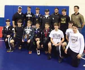 Photo by Patrick Calcutt:   Southland's wrestlers, front row from left: Brent Allegood, Zach Calcutt, Tanner Rundle, Cole Landreth, Terry Kennedy, Reagan Trollinger, Jordan Grinnell, and Billy Calcutt. Back row, from left:  Coach Mike Smith, Morgan Youngdale, Stephen Turton, Cale Revell, Coach JR Jones, Brandon Revell, and Coach Nick McGehee.