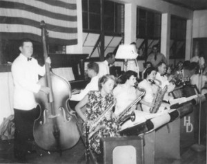 Ira T. Jones playing bass fiddle was the sign man for the Rylander.  This is Hank Dudley's band playing at the American Legion in the old Citizens Bank building. Faye Lunsford (Saliba) is playing tenor sax on the end. Hank is playing trumpet.