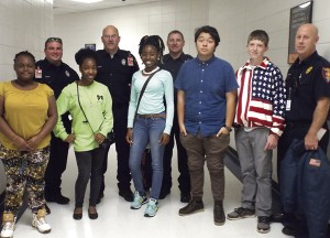 Americus Fire and Emergency Services and eighth-graders, Rosnice Williams, Tymia Williams, Ty'kessiana Angry, Joshua Laines and Caleb Beamon.