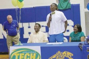 Michael Murray/Americus Times-Recorder:   Mekall Yancie addresses the crowd before inking his NLI during the ceremony at ASHS on Feb. 3.Yancie will be playing with Arkansas Tech in the 2016-17 season. Yancie is joined by his parents at the table.