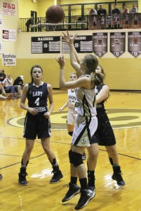 Michael Murray/Americus Times-Recorder:   Sydney Payne takes a shot from the perimeter during the Lady Raiders' Jan. 29 contest. Payne contributed four points and four steals to the Southland victory.