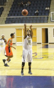 Michael Murray/Americus Times-Recorder:   Yvonna Dunkley (15) tosses in a free throw on Jan. 27 in Americus. Dunkley added 12 [points to GSW's tally in the Jan. 30 test.