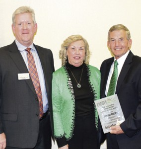 Jay Roberts, chairman of the board, Sumter County of Commerce, at left, with Sparky Reeves, recipient of the inaugural Sparky Reeves Sumter Trustee Award. Allene Reeves is shown in the center.