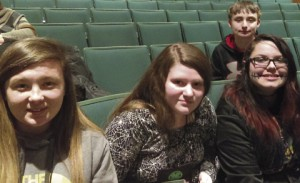 Maribeth Arthur, Anna Trussell, Shiann Smith, and Caleb Smith relax between presentations at Rock Eagle.