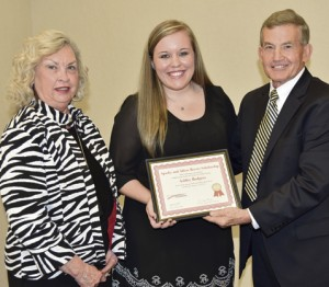 Ashley Rodgers, center, South Georgia Technical College's 2016 GOAL winner, is shown receiving a framed certificate and scholarship from Allene and Sparky Reeves.