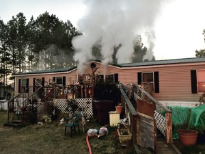 Firefighters found smoke coming from this double-wide mobile home on Tallent Store Road early Thursday morning.