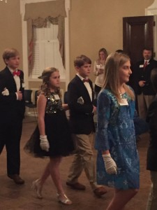 The Grand March kicks off the ball. Shown are Lainey Collier, Ella and Chase Ledger.