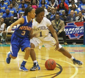 Michael Murray/Americus Times-Recorder:   ASHS' Atyanna Gaulden drives past Veteran's Kya Cochran as she makes a break for the bucket during the second half of the state championship game in Macon. Gaulden scored 16 points in the contest.