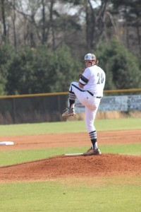 Submitted by Chuck Cheek: Brett Usry winds up on the mound during the Wildcats' March 15 contest against Brookstone. Usry struck out 12 batters in five innings on the hill for the Wildcats.