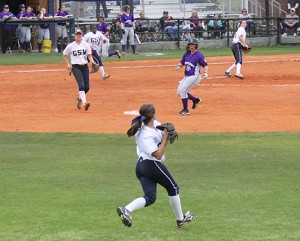 Michael Murray/Americus Times-recorder:   GSW center fielder, Ella Hawkins, looks to halt a YHC runner's progress at second base after catching a pop fly during the Lady 'Canes' March 25 nightcap.
