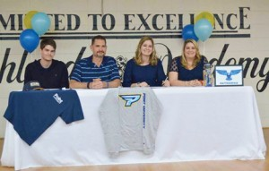 Submitted by Southland Academy:   Southland's Emily Brown pauses for a photo with her family after inking her scholarship agreement with Point University. Brown will join the school's cheerleading squad during the 2016-17 season.