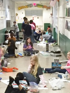 Submitted by Furlow Charter School: Furlow Charter School students spread out in the school's hallway to make room for their projects as they create posters and dioramas to show their knowledge of animal habitats.
