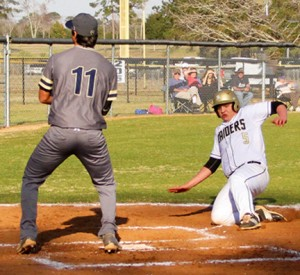 Michael Murray/Americus Times-Recorder: Southland's Michael Hudgens slides into home plate on a passed ball during the second inning of the Raiders' March 8 contest against Tiftarea. *Image has been altered to remove an extraneous element.