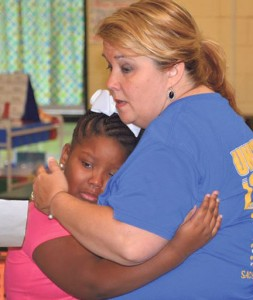 Submitted by Sumter County Schools: Sumter County Elementary teacher, Sheryl Rush, demonstrates the caring environment that she cultivates in her classroom as she comforts an upset student.