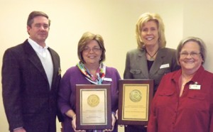 Photo submitted by Magnolia Manor:   The Americus Campus National Quality Award recipients are, from left, Hill Fort, senior vice president for operations of Magnolia Manor; Susie Fussell, administrator for Magnolia Manor of Americus Nursing and Rehabilitation Center displaying their Quality Award; Jane House, administrator for Magnolia Manor of Americus Assisted Living displaying their Quality Award; and Barbara Mitchell, vice president for clinical services and corporate compliance for Magnolia Manor.