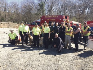 Shown above are members of the Georgia Piedmont Region Search and Rescue K-9 team (green shirts) from Henry County and members of the Sumter County Fire & Rescue dive team, who, working in concert, recovered the body of an Americus man in the Muckalee Creek who had been missing since Feb. 4.