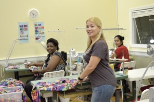 In photo below, in the sewing room of Tepuy Activewear are Elena Carne, foreground, and seamstresses Charity and Sandra.